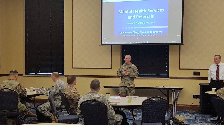 Chaplain (Maj.) Randal Johnson, U.S. Army, makes presentation